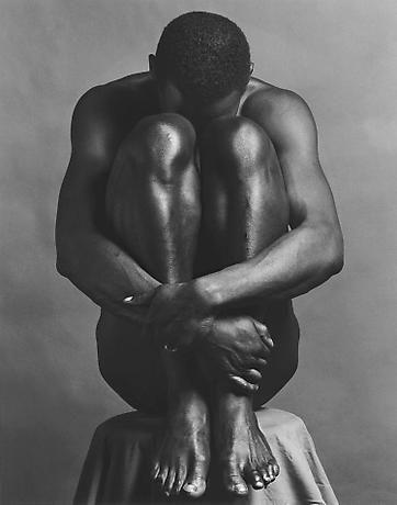 man huging himself